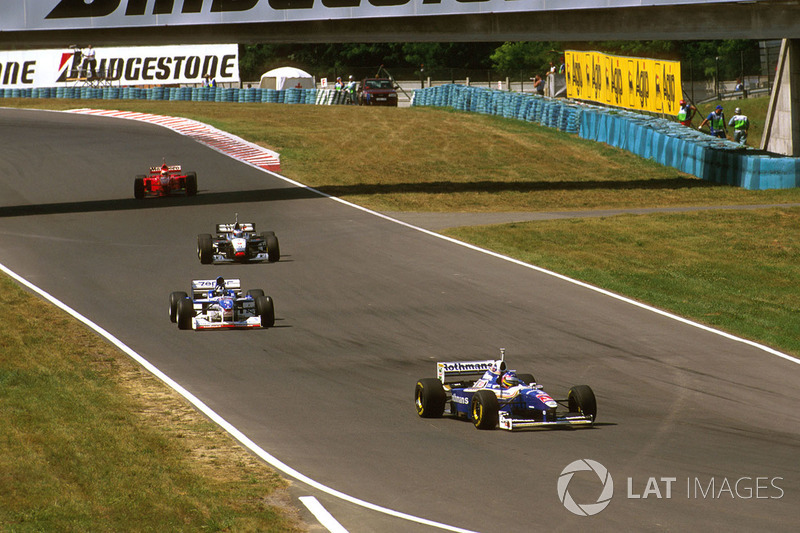 Jacques Villeneuve, Williams Renault, Damon Hill, Arrows A18 Yamaha, Mika Hakkinen, McLaren MP4/12 Mercedes and Eddie Irvine, Ferrari F310B