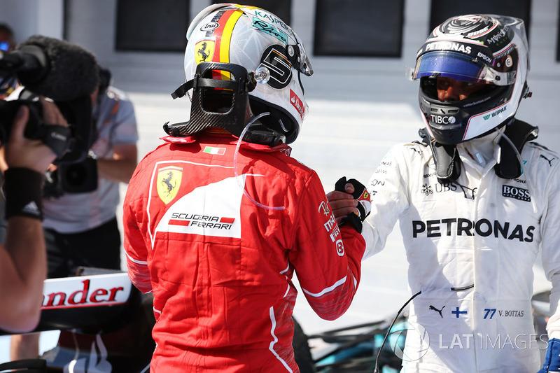 Valtteri Bottas, Mercedes AMG F1, congratulates winner Sebastian Vettel, Ferrari, in parc ferme