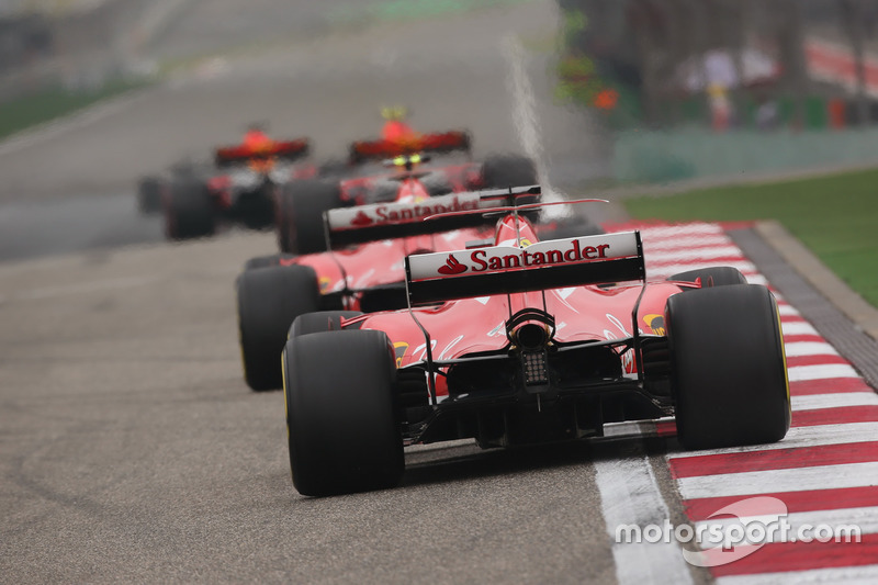 Max Verstappen, Red Bull Racing RB13, leads Kimi Raikkonen, Ferrari SF70H, and Sebastian Vettel, Ferrari SF70H
