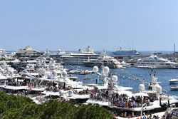 Fans on the yachts in the harbour