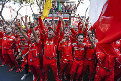 Ferrari team and mechanics celebrate in parc ferme