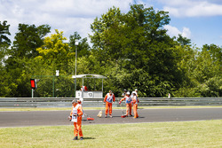 Marshals clear debris from the circuit