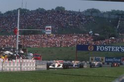 Ayrton Senna, McLaren MP4/6 Honda leads Nigel Mansell, Williams FW14 Renault, Riccardo Patrese, Williams FW14 Renault and Alain Prost, Ferrari 643