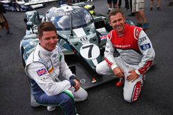 Guy Smith and Tom Kristensen pose, the Bentley Speed 8 LMP1 that they shared to victory at Le Mans i