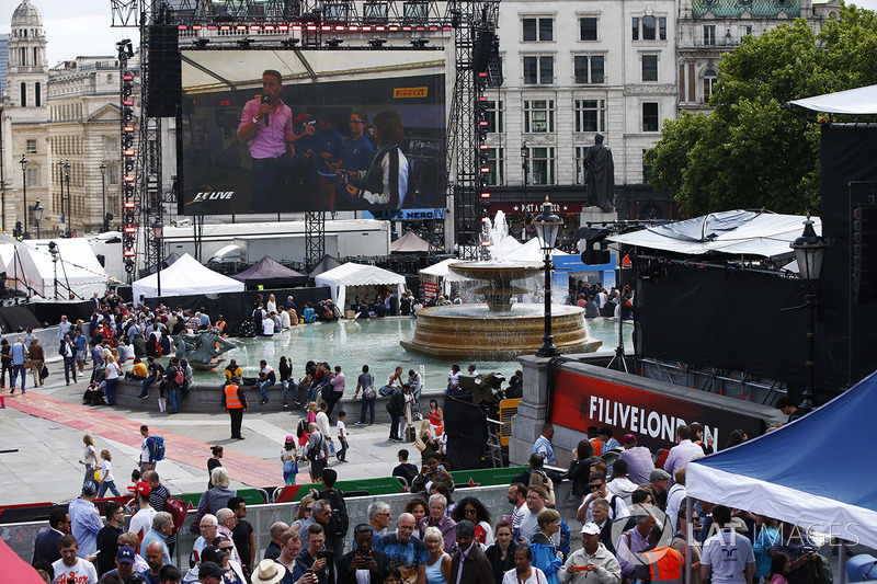 Fans watch the big screen entertainment in Trafalgar Square