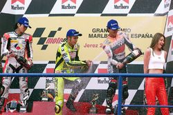 Podium: race winner Valentino Rossi, Honda, second place Norick Abe, Yamaha, third place Alex Crivil