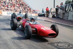 Lorenzo Bandini, Ferrari 158/246; Graham Hill, BRM P261