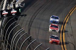 Kurt Busch, Stewart-Haas Racing Ford, takes the checkered flag in front of Ryan Blaney, Wood Brothers Racing Ford and A.J. Allmendinger, JTG Daugherty Racing Chevrolet