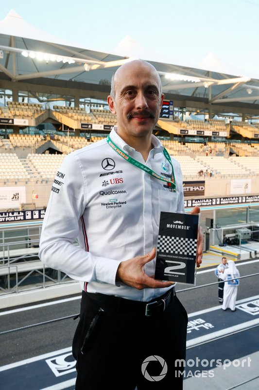 A Movember prize is awarded to a Mercedes team member