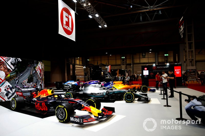 A Red Bull Racing RB15 and a Mercedes AMG F1 W10 on the F1 Racing stand