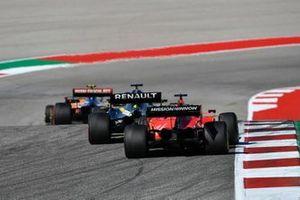 Lando Norris, McLaren MCL34, leads Lewis Hamilton, Mercedes AMG F1 W10, and Sebastian Vettel, Ferrari SF90
