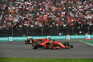 Sebastian Vettel, Ferrari SF90, leads Alexander Albon, Red Bull RB15