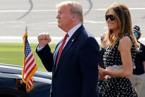 President Donald J. Trump and First Lady Melania Trump walk to their car after then command at the Daytona 500