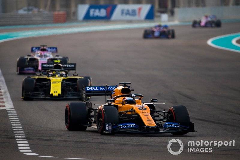 Carlos Sainz Jr., McLaren MCL34, leads Nico Hulkenberg, Renault F1 Team R.S. 19, and Sergio Perez, Racing Point RP19