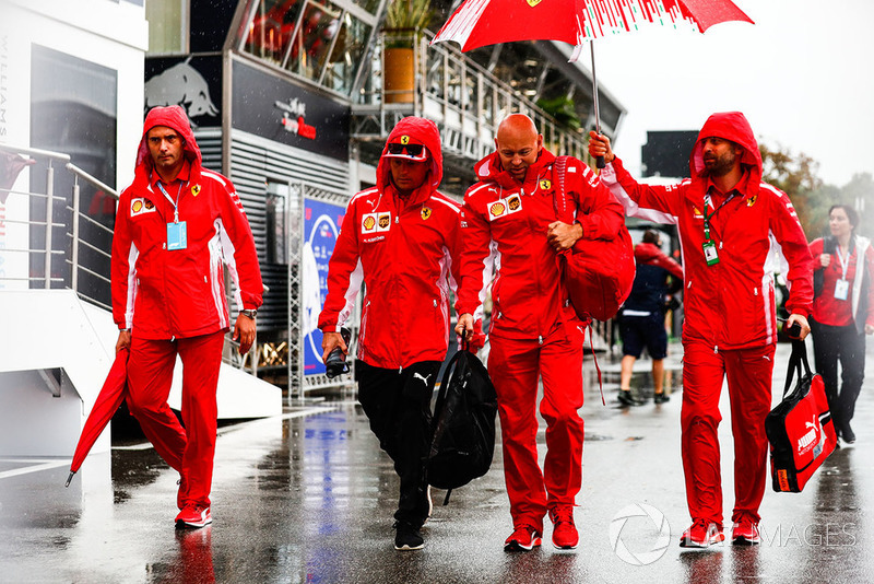 Kimi Raikkonen, Ferrari, arrives in the paddock
