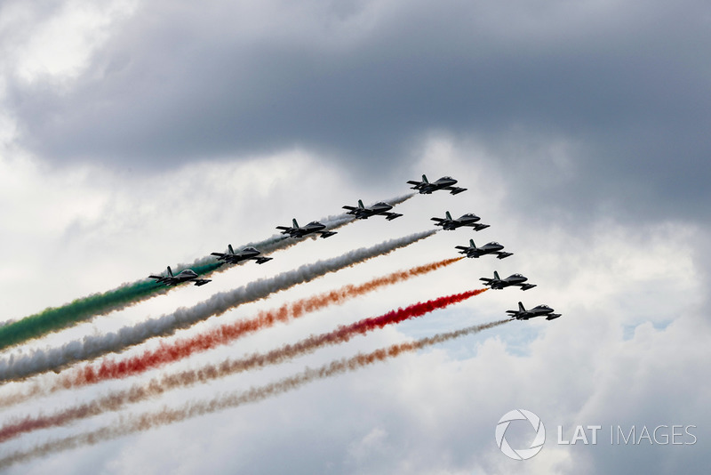 The Italian Air Force Aerobatics team, Frecce Tricolori, display for the crowd in their Aermacchi MB339A aircraft