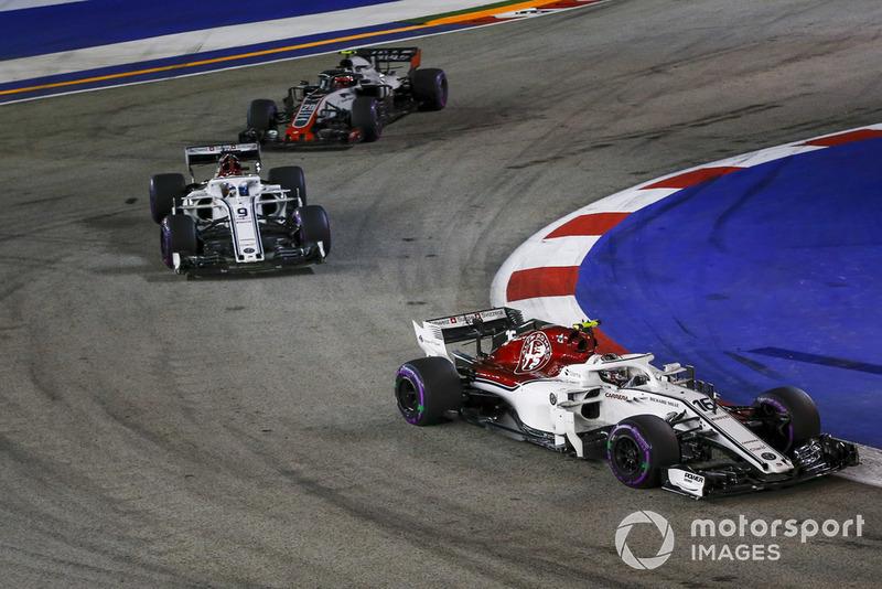 Charles Leclerc, Sauber C37, Marcus Ericsson, Sauber C37 and Kevin Magnussen, Haas F1 Team VF-18