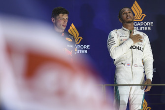 Lewis Hamilton, Mercedes AMG F1 celebrates on the podium with Max Verstappen, Red Bull Racing