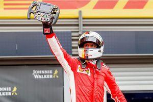 Race winner Sebastian Vettel, Ferrari celebrates in parc ferme with Ferrari SF71H steering wheel