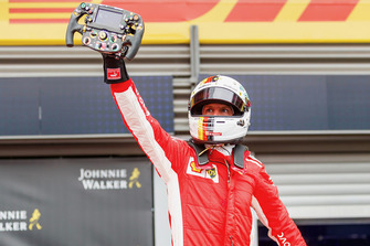 Race winner Sebastian Vettel, Ferrari celebrates in parc ferme with Ferrari SF71H steering wheel