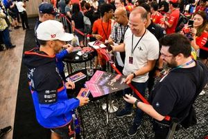 Pierre Gasly, Toro Rosso and Daniil Kvyat, Toro Rosso sign autographs for fans