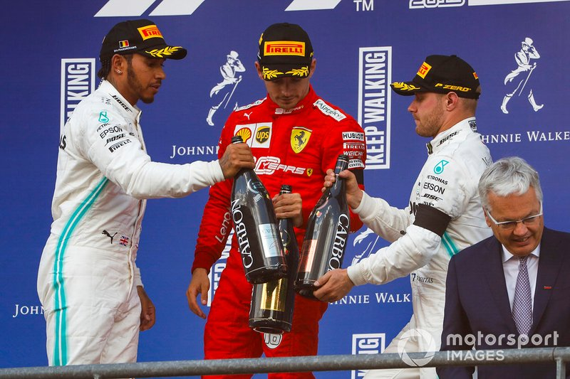 Lewis Hamilton, Mercedes AMG F1, 2nd position, Charles Leclerc, Ferrari, 1st position, and Valtteri Bottas, Mercedes AMG F1, 3rd position, celebrate on the podium