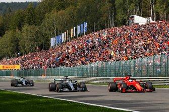 Sebastian Vettel, Ferrari SF90, leads Lewis Hamilton, Mercedes AMG F1 W10 and Valtteri Bottas, Mercedes AMG W10