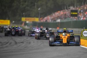 Lando Norris, McLaren MCL34, leads Romain Grosjean, Haas F1 Team VF-19, Sergio Perez, Racing Point RP19, and Kevin Magnussen, Haas F1 Team VF-19