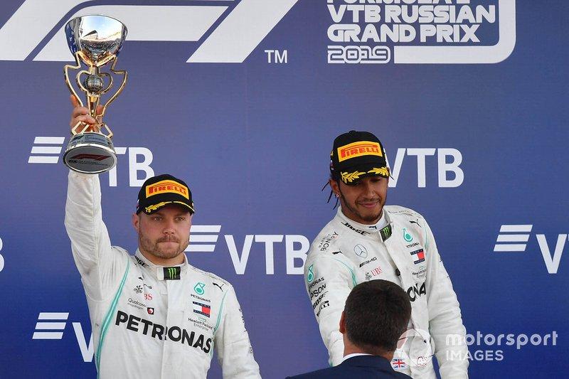 Valtteri Bottas, Mercedes AMG F1, 2nd position, receives his trophy alongside Lewis Hamilton, Mercedes AMG F1, 1st position