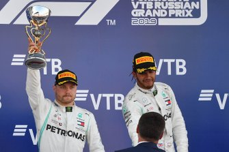 Valtteri Bottas, Mercedes AMG F1, 2nd position, receives his trophy alongside Lewis Hamilton, Mercedes AMG F1, 1st position