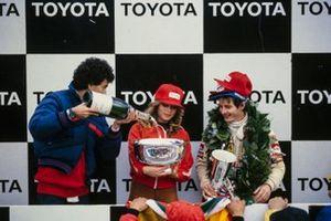 Gilles Villeneuve, Ferrari celebrates victory on the podium