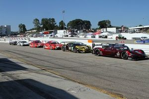 Cars wait in pit lane for the green flag