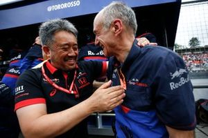Masashi Yamamoto, General Manager, Honda Motorsport, and Franz Tost, Team Principal, Toro Rosso, celebrate a podium finish