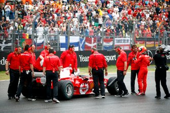 Mechanics with Mick Schumacher and the Ferrari F2004 driven by his father Michael Schumacher