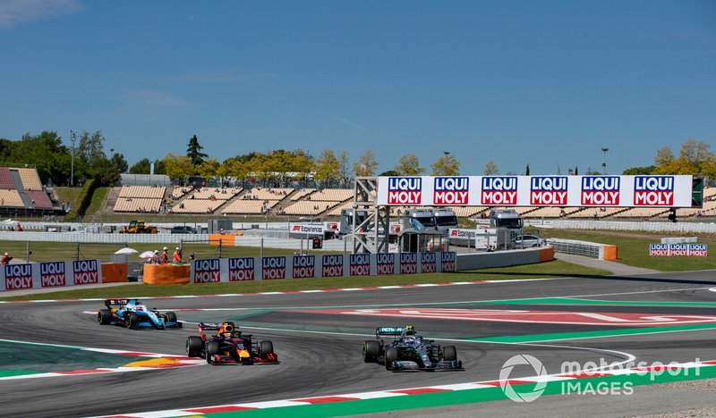 Valtteri Bottas, Mercedes AMG W10, leads Max Verstappen, Red Bull Racing RB15, and George Russell, Williams Racing FW42