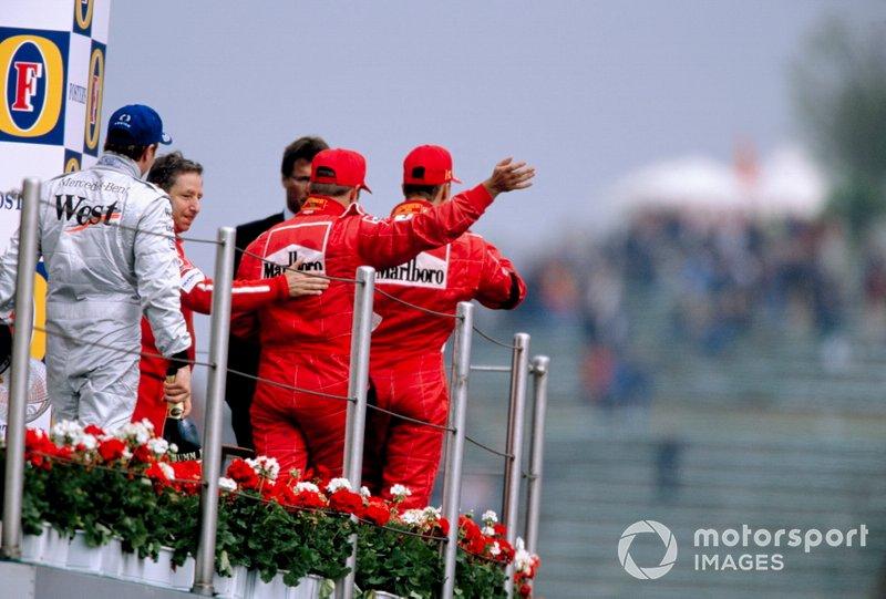 Podio: el ganador Michael Schumacher, Kimi Raikkonen y Rubens Barrichello