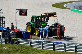 Marshals remove the damaged car of Valtteri Bottas, Mercedes AMG W10