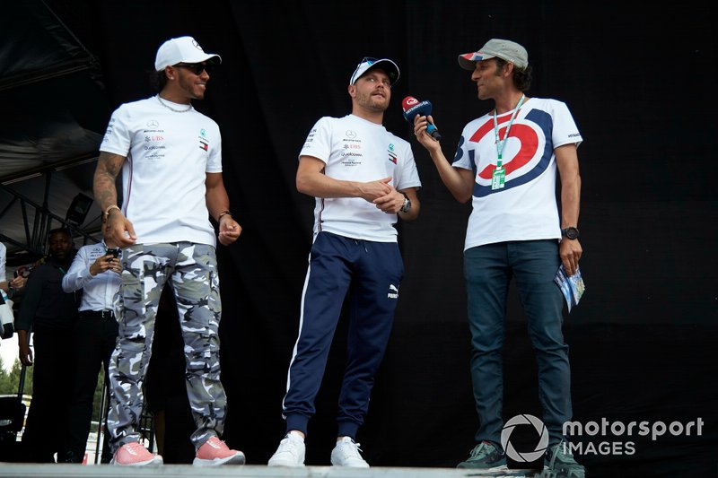 Lewis Hamilton, Mercedes AMG F1 and Valtteri Bottas, Mercedes AMG F1 on stage in the fan zone