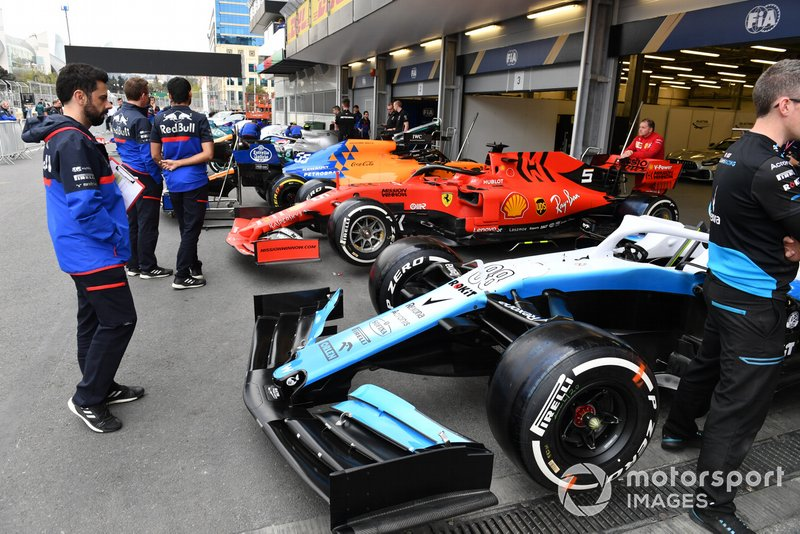 Cars of Robert Kubica, Williams FW42, Sebastian Vettel, Ferrari SF90 and Carlos Sainz Jr., McLaren MCL34 in scrutineering