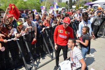 Charles Leclerc, Ferrari takes a selfie with a fan