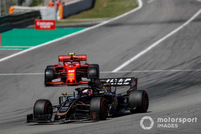 Romain Grosjean, Haas F1 Team VF-19, leads Charles Leclerc, Ferrari SF90
