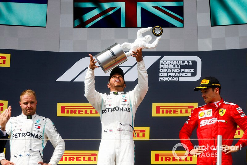 Valtteri Bottas, Mercedes AMG F1, Race Winner Lewis Hamilton, Mercedes AMG F1 and Charles Leclerc, Ferrari on the podium with the trophy