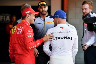 Sebastian Vettel, Ferrari, talks with pole man Valtteri Bottas, Mercedes AMG F1, after Qualifying