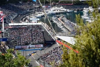 Fans watch the on track action from the grandstands