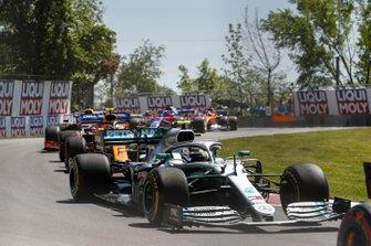 Valtteri Bottas, Mercedes AMG W10, leads Lando Norris, McLaren MCL34
