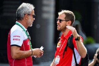 Beat Zehnder, Team Manager, Alfa Romeo Racing and Sebastian Vettel, Ferrari in the paddock