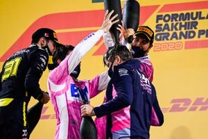 Sergio Perez, Racing Point, 1st position, and Lance Stroll, Racing Point, 3rd position, pour rose water over Andy Stevenson, Sporting Director, Racing Point, on the podium