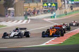 Pierre Gasly, AlphaTauri AT01, and Lando Norris, McLaren MCL35, and Sebastian Vettel, Ferrari SF1000