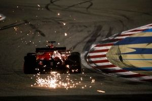 Sebastian Vettel, Ferrari SF1000, kicks up some sparks