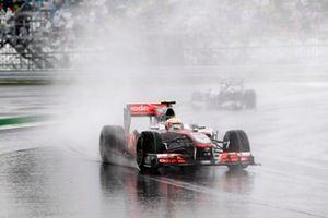 Lewis Hamilton, McLaren MP4-25 Mercedes, leads Nico Rosberg, Mercedes GP W01